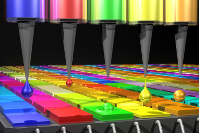 In this illustration, the Quantum Dot (QD) spectrometer device is printing QD filters—a key fabrication step. Other spectrometer approaches have complicated systems in order to create the optical structures needed. Here in the QD spectrometer approach, the optical structure, QD filters, are generated by printing liquid droplets. This approach is unique and advantageous in terms of flexibility, simplicity and cost reduction. Image: Mary O'Reilly