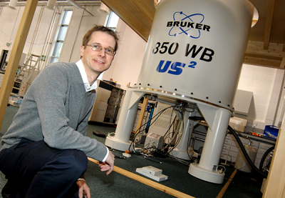 Photo of Steven Brown with NMR spectrometer